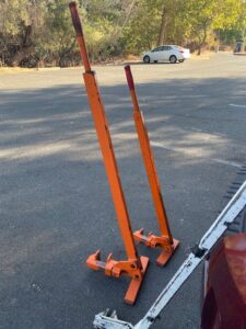 two orange weed wrench tools